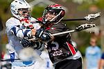 Corona Del Mar, CA 04/06/10 - Zach Dutra (Danville/Monte Vista #23) and unknown Corona Del Mar player in action during the Corona Del Mar-Danville/Monte Vista lacrosse game.