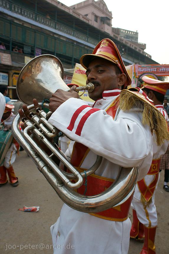 Musician in a parade in Varanasi, India