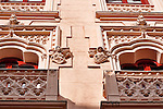 Looking up at the decorated facade and balconies of a building in Toledo, Spain