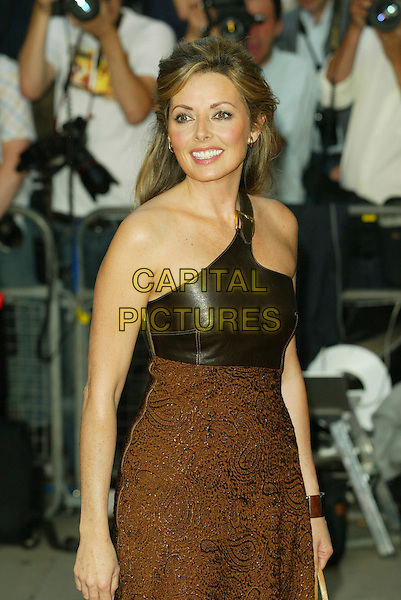 CAROL VORDERMAN.The 8th Anual GQ Men of The Year Awards,.The Royal Opera House,.London, 6th September 2005.half length turquoise arrivals embossed brown paisley leather buckle strap .www.capitalpictures.com.sales@capitalpictures.com.© Capital Pictures.