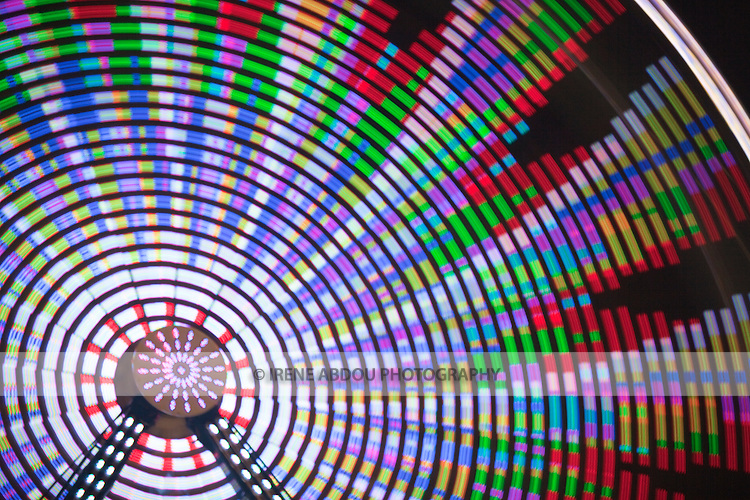 A long exposure is used to transform the lights of the ferris wheel into abstract designs at the Montgomery County Agricultural Fair in Gaithersburg, Maryland.