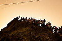 Crowds of catholic followers watch the Good Friday procession on the hill of San Cristobal during the Holy week in Lima, Peru, 30 March 2013. The annual Passion Of Christ procession, held as part of Easter celebrations, starts in Lima downtown and, followed by thousands of catholic believers, it climbs to the top of the dry and rocky hill of San Cristobal, where Mario Valencia, who has been playing the role of Jesus Christ for more than 30 years, is symbolically crucified.
