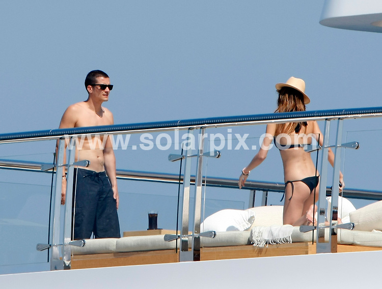 **ALL ROUND EXCLUSIVE PICTURES FROM SOLARPIX.COM**.**SYNDICATION RIGHTS FOR UK AND SPAIN ONLY**.Orlando Bloom and girlfriend Miranda Kerr on board the super yacht Raising Sun, in the bay of Cannes, during the 62nd Cannes International Film Festival 2009, Cannes, France. 19 May 2009..This pic: Orlando Bloom and girlfriend Miranda Kerr..JOB REF: 9048 CPR (Kongsted)  DATE: 19_05_2009.**MUST CREDIT SOLARPIX.COM OR DOUBLE FEE WILL BE CHARGED**.**ONLINE USAGE FEE GBP 50.00 PER PICTURE - NOTIFICATION OF USAGE TO PHOTO @ SOLARPIX.COM**.**CALL SOLARPIX : +34 952 811 768 or LOW RATE FROM UK 0844 617 7637**