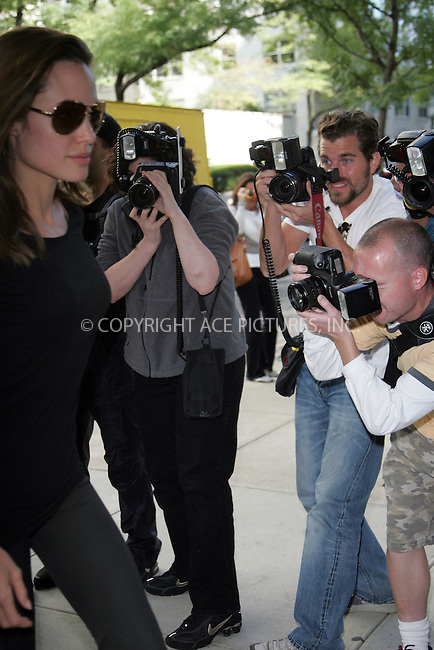 WWW.ACEPIXS.COM . . .  ....September 19 2007, New York City....Actress Angelina Jolie picked up her adpoted son Maddox from the Lycee de Francais on the Upper East Side amidst photographers and fans.......Please byline: DAVID MURPHY - ACEPIXS.COM.. *** ***  ..Ace Pictures, Inc:  ..Tel: 646 769 0430..e-mail: info@acepixs.com..web: http://www.acepixs.com