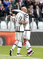 Calcio, Serie A: Juventus vs Carpi. Torino, Juventus Stadium, 1 maggio 2016.<br /> Juventus' Simone Zaza, left, is hugged by his teammate Patrice Evra after scoring during the Italian Serie A football match between Juventus and Carpi at Turin's Juventus Stadium, 1 May 2016.<br /> UPDATE IMAGES PRESS/Isabella Bonotto