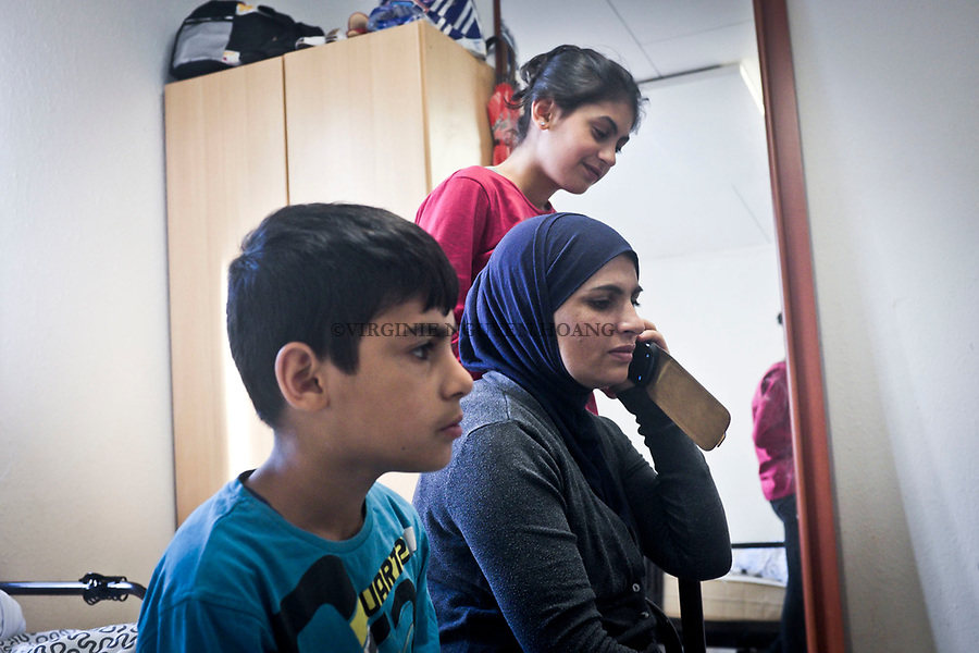 GERMANY, Pulheim: After a trip from Italy to Germany in July, the children started school in September. They are now speaking German. On the phone, Maha is speaking with Abu Ali who was doing some shopping.