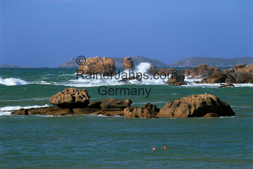 France, Brittany, near Ploumanac`h: Waves breaking on rocks along the Pink Granite Coast with the Ile aux Moines in background