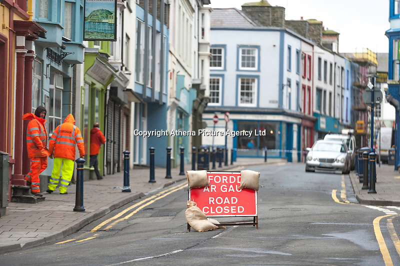"""WEATHER PICTURE WALES<br />Pictured: A street that has been closed off because of roof tiles coming off in Aberystwyth, Ceredigion, Wales. Wednesday 02 March 2016<br />Re: Roads have been closed, homes left without power and tiles blown from roofs after Storm Jake brought wintry showers and high winds to Wales.<br />Yellow Met Office """"be aware"""" warnings of snow, ice and wind were issued for most of Wales for Wednesday morning.<br />Gusts - forecast to reach up to 70mph - caused roof tiles to fall and trees to be blown over in Aberystwyth, with roads closed as a precaution."""
