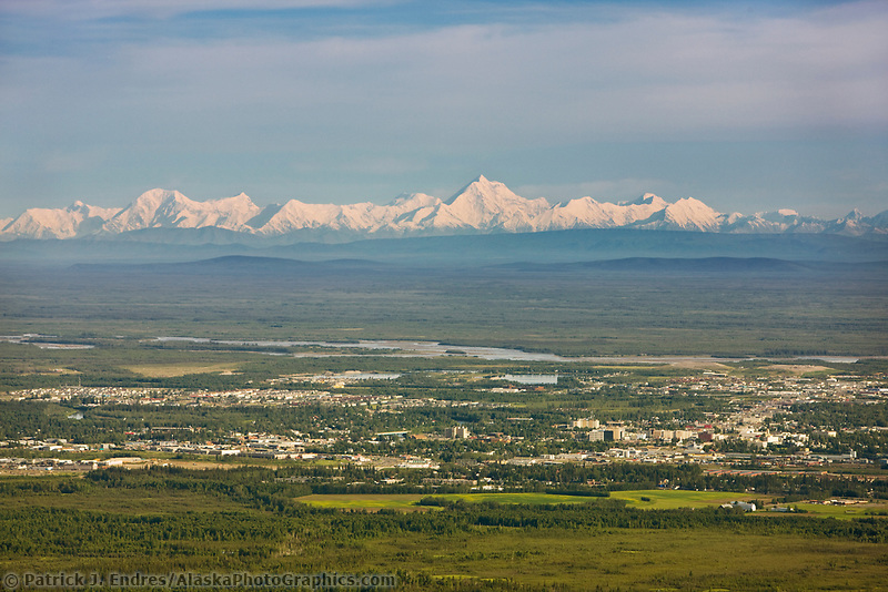 Aerial of the city of Fairbanks and mount Hayes of the Alaska Range in the distance.