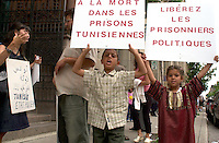 Montreal, June 28th 2001<br /> Sophie Dorais (far left), 8 year old Farouk and 5 year old Soumaya take part in a peaceful demonstration on St-Utrbain Street in Montreal, June 28th 2001, for the release of over 1000 politicial prisonners still in jail  in tunisia, and also for more freedom of expression in that country.<br /> Similar demonstration happened today around the globe.<br /> <br /> <br /> (Photo : (c) 2001, Pierre Roussel<br /> NOTE :  Nikon D-1 JPEG, opened with QUIMAGE ICC profile, saved as Adobe RG 1998