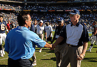 Sept. 17, 2006; San Diego, CA, USA; San Diego Chargers head coach Marty Schottenheimer shakes hands with Tennessee Titans head coach Jeff Fisher following the game at Qualcomm Stadium in San Diego, CA. Mandatory Credit: Mark J. Rebilas