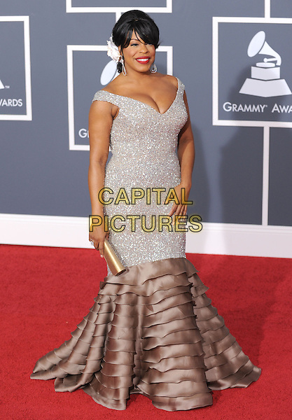 NIECY NASH.Arrivals at the 52nd Annual GRAMMY Awards held at The Staples Center in Los Angeles, California, USA..January 31st, 2010.grammys full length silver beige grey gray beads beaded off the shoulder fishtail layers layered dress cleavage .CAP/RKE/DVS.©DVS/RockinExposures/Capital Pictures