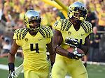 EUGENE, OR -SEPTEMBER 06: Defensive back Ifo Ekpre-Olomu #14 of the Oregon Ducks celebrates with defensive back Erick Dargan #4 of the Oregon Ducks after intercepting a pass during the fourth quarter of the game against the Michigan State Spartans at Autzen Stadium on September 6, 2014 in Eugene, Oregon. Oregon won the game 46-27. (Photo by Steve Dykes/Getty Images) *** Local Caption *** Ifo Ekpre-Olomu; Erick Dargan