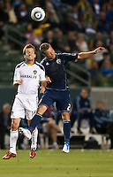 CARSON, CA – May 14, 2011: LA Galaxy midfielder Mike Magee (18) and Sporting KC midfielder Michael Harrington (2) go high to battle for the ball during the match between LA Galaxy and Sporting Kansas City at the Home Depot Center in Carson, California. Final score LA Galaxy 4, Sporting Kansas City 1.