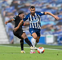 Brighton & Hove Albion's Martin Montoya (right) is tackled by Manchester City's Raheem Sterling (left) <br /> <br /> Photographer David Horton/CameraSport<br /> <br /> The Premier League - Brighton & Hove Albion v Manchester City - Saturday 11th July 2020 - The Amex Stadium - Brighton<br /> <br /> World Copyright © 2020 CameraSport. All rights reserved. 43 Linden Ave. Countesthorpe. Leicester. England. LE8 5PG - Tel: +44 (0) 116 277 4147 - admin@camerasport.com - www.camerasport.com