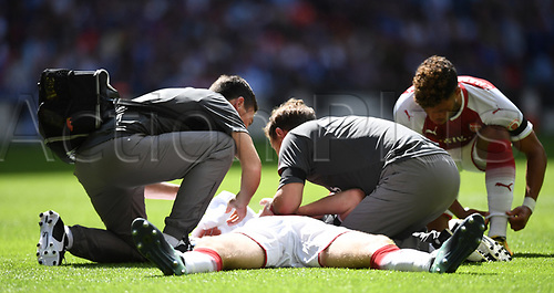 August 6th 2017, Wembley Stadium, London, England; FA Community Shield Final; Arsenal versus Chelsea; Per Mertesacker of Arsenal lies injured