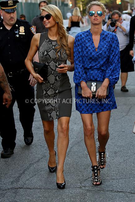 WWW.ACEPIXS.COM<br /> <br /> September 8 2013, New York City<br /> <br /> Paris Hilton (L) and Nicky Hilton arrive at Mercedes-Benz New York Fashion Week on September 8 2013 in New York City<br /> <br /> By Line: Zelig Shaul/ACE Pictures<br /> <br /> <br /> ACE Pictures, Inc.<br /> tel: 646 769 0430<br /> Email: info@acepixs.com<br /> www.acepixs.com