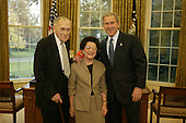 United States President George W. Bush meets with Leszek Kolakowski and his wife Tamara, of Oxford, England, in the Oval Office at the White House in Washington, DC on Wednesday, November 5, 2003. Professor Kolakowski is the 2003 recipient of the John W. Kluge Prize in Human Sciences. The international honor is awarded by the Library of Congress for lifetime achievement in the humanistic and social sciences. A philosopher, historian and essayist, Professor Kolakowski has written more than 30 books and hundreds of articles on the history of philosophy and the philosophy of religion.<br /> Mandatory Credit: Paul Morse / White House via CNP