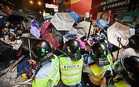 Pro-democracy protesters are beaten by Hong Kong police officers with truncheons, shortly before the police lost control of the area, and thus ceding it back to the protesters, who had only just lost it to the police hours earlier in a pre-dawn raid, Mong Kok, Kowloon, Hong Kong, China, 18 October 2014.