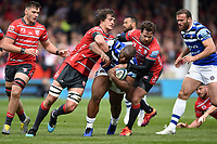 Beno Obano of Bath Rugby is double-tackled by Franco Mostert and Danny Cipriani of Gloucester Rugby. Gallagher Premiership match, between Gloucester Rugby and Bath Rugby on April 13, 2019 at Kingsholm Stadium in Gloucester, England. Photo by: Patrick Khachfe / Onside Images