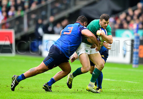 13.02.2016. Stade de France, Paris, France. 6 Nations Rugby international. France versus Ireland.  Robbie Henshaw ( Ireland ) tackled by Uini Atonio ( France )