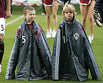 7 April 2007: Local youngsters who came out with the Colorado Rapids players (names unknown) wear Colorado players' warmup jackets like personal tents to help them bear the freezing temperature at game time. The Colorado Rapids defeated DC United 2-1 at Dick's Sporting Goods Park in Denver, Colorado in the opening game of the MLS regular season.