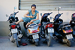 Woman On Scooter Using Cell Phone
