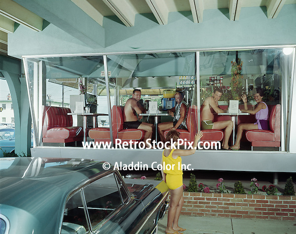 Woman waving to diners in the Eden Roc Motel coffee shop.