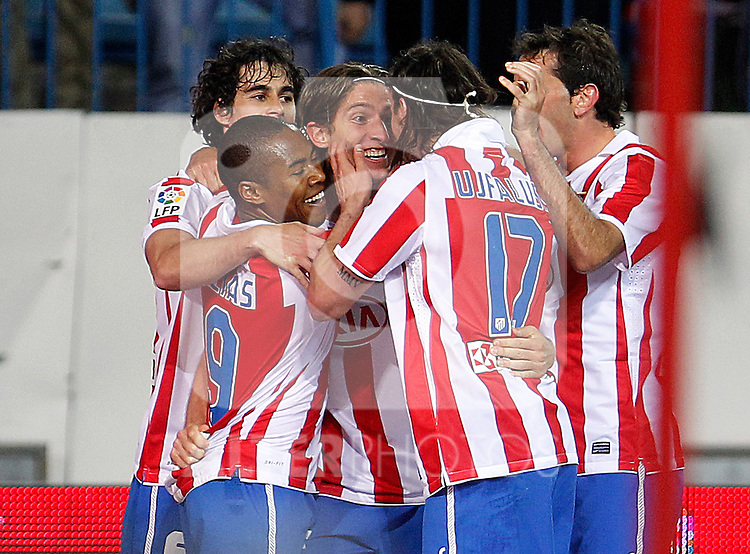 Atletico de Madrid's Tiago Cardoso, Elias, Filipe Luis, Tomas Ujfalusi and Diego Godin celebrate goal during La Liga match.March 5,2011. (ALTERPHOTOS/Acero)