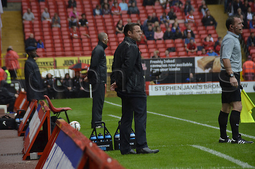 24.08.2013. The Valley, Charlton, London, England. FA Championship football. Charlton FC versus Doncaster Rovers.   Paul Dickov with Chris Powell in background