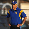 East Meadow varsity softball head coach Stew Fritz keeps an eye on the action during a Nassau County game against host Long Beach High School on Monday, May 4, 2015. Long Beach won by a score of 2-0.<br /> <br /> James Escher