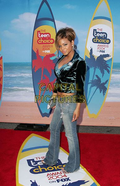 CHRISTINA MILIAN.The 2004 Teen Choice Awards held at The Universal Ampitheatre in Universal City, California .August 8, 2004.full length, surf board, jeans, denim, blue black crush velvet jacket.www.capitalpictures.com.sales@capitalpictures.com.Supplied By Capital Pictures