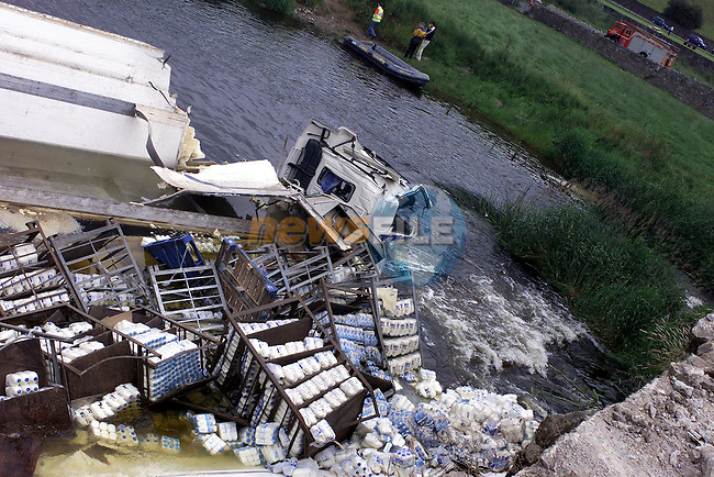 The remains of the Lorry that crashed on the N2 at slane bridge. The lorry roaled over after crashing through the bridge wall and falling over thirty feet into the river Boyne. The lorry driver died soon after the crash before rescuers could reace him..Picture Fran Caffrey Newsfile