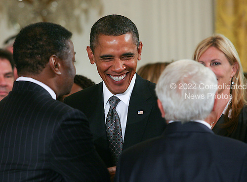 United States President Barack Obama greets guests as he delivers remarks at the President's Export Council meeting in the East Room of the White House in Washington, D.C. on Thursday, September 16, 2010.  On hand for the meeting was Boeing CEO James McNerney Jr., Xerox Chairman and CEO Ursula Burns, U.S. Secretary of Agriculture Tom Vilsack, US Secretary of Commerce Gary Locke, Senior Advisor Valerie Jarrett, and other business leaders.  .Credit: Gary Fabiano / Pool via CNP