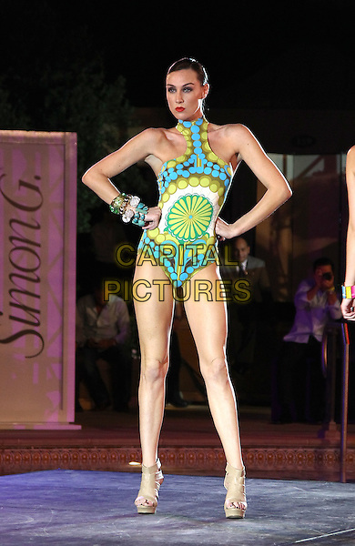 Model .Simon G. Jewelry Summer Soiree at Azure Luxury pool at the Palazzo Las Vegas,Las Vegas, Nevada, USA, .4th June 2011..full length modeling catwalk runway  bathing suit swimsuit hands on hips green .CAP/ADM/MJT.© MJT/AdMedia/Capital Pictures.