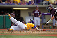 LSU Tigers first baseman Chris Chinea (26) slides home past Texas A&M catcher Michael Barash (5) during the Southeastern Conference baseball game on April 25, 2015 at Alex Box Stadium in Baton Rouge, Louisiana. Texas A&M defeated LSU 6-2. (Andrew Woolley/Four Seam Images)
