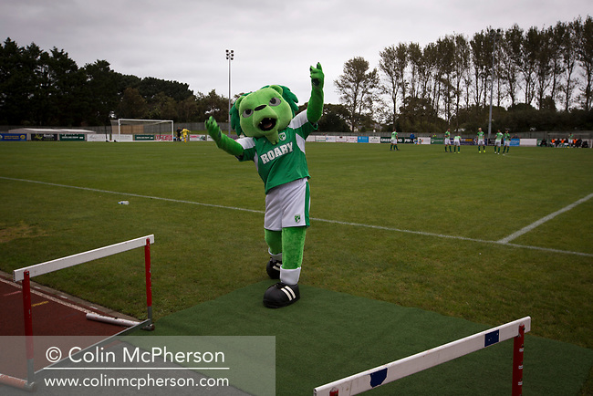 Home mascot Roary the Lion tries to enthuse the crowd before kick-off as Guernsey take on Corinthian-Casuals in a Isthmian League Division One South match at Footes Lane. Formed in 2011, Guernsey FC are a community club located in St. Peter Port on the island of Guernsey and were promoted to the Isthmian League Division One South in 2013. The visitors from Kingston upon Thames won the fixture by 1-0, watched by a crowd of 614 spectators.