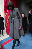 First lady Michelle Obama arrives during the presidential inauguration on the West Front of the U.S. Capitol January 21, 2013 in Washington, DC.   Barack Obama was re-elected for a second term as President of the United States.     .Credit: Win McNamee / Pool via CNP