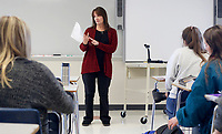 NWA Democrat-Gazette/DAVID GOTTSCHALK Annette Roller reviews Thursday, March 8, 2018, the weeks schedule and problems that will be on an upcoming quiz in her Plane Trigonometry class at Rogers High School. A new state law allows low-income students (eligible for free or reduced-price lunches) to take up to six credit hours of endorsed concurrent enrollment courses taught on the grounds of the student's public school district and by a teacher employed by that district.