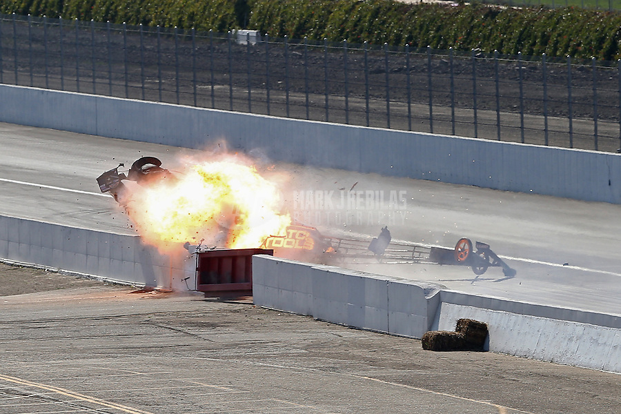 Feb. 17, 2013; Pomona, CA, USA; NHRA top fuel dragster driver Antron Brown explodes an engine in flames blowing a tire and crashes during the Winternationals at Auto Club Raceway at Pomona. Antron would be uninjured in the incident.  Mandatory Credit: Mark J. Rebilas-
