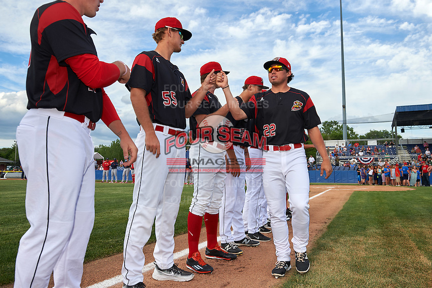 Batavia Muckdogs first baseman Joseph Chavez (22) fits bumps teammate Justin Langley (55) during introductions before a game against the State College Spikes on June 22, 2016 at Dwyer Stadium in Batavia, New York.  State College defeated Batavia 11-1.  (Mike Janes/Four Seam Images)