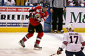 February 22nd 2008:  Derek Smith (24) of the Binghamton Senators passes the puck during a game as Dan Collins (17) defends vs. the Rochester Amerks at Blue Cross Arena at the War Memorial in Rochester, NY.  The Senators defeated the Amerks 4-0.   Photo copyright Mike Janes Photography