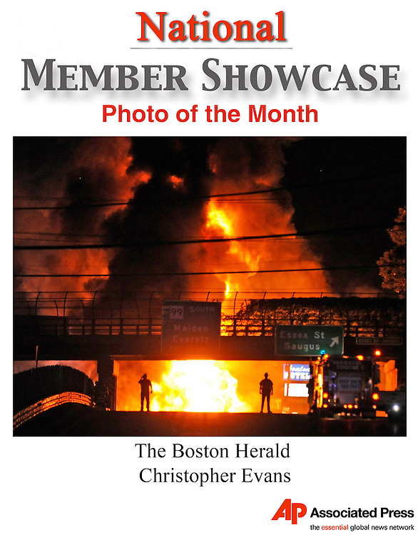 EDS NOTE - THE ASSOCIATED PRESS MANAGING EDITORS HAVE HONORED THE FOLLOWING IMAGE AS APME'S PHOTO OF THE MONTH FOR JULY 2011 - FILE - In this July 23, 2011 file photo, a fire burns out of control after a gasoline tanker truck crashed and exploded near Essex Street in Saugus, Mass., triggering smaller explosions, sending fire streaming down a nearby brook and killing the truck driver. (AP Photo/The Boston Herald, Christopher Evans, File)  BOSTON GLOBE OUT; METRO BOSTON OUT; MAGS OUT; ONLINE OUT; NO SALES; NO TV; QUINCY OUT