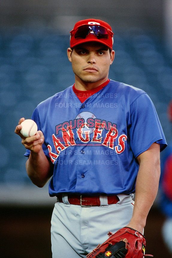 Ivan Rodriguez of the Texas Rangers during a game against the Anaheim Angels at Angel Stadium circa 1999 in Anaheim, California. (Larry Goren/Four Seam Images)