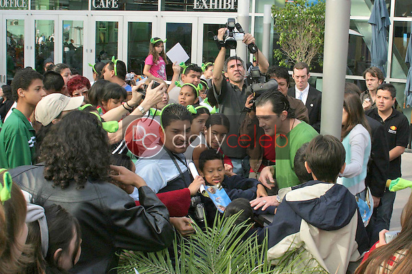 Antonio Banderas surrounded by fans