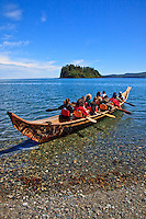 NO MODEL RELEASES.   Paddlers paddling a Haida canoe at the Haida Heritage Centre and Museum in Skidegate on Graham Island, Haida Gwaii, British Columbia, Canada..   Haida Heritage Centre and Museum in Skidegate on Graham Island, Haida Gwaii, British Columbia, Canada.