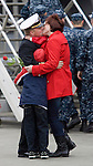 Lt. Sean Kugler, is welcomed by his family, Stephen, 7, Shianne, 3, and his wife, Melissa, after the USS John C. Stennis, a 1,092-foot-long aircraft carrier pulled into it's homeport on on March, 2, 2012 at Naval Station Kitsap in Bremerton, WA.  The carrier and it's 3,200 crew members arrived Friday after spending a six-month deployment in support of  Middle East operations.   ©2012 Jim Bryant Photo. All Rights Reserved..