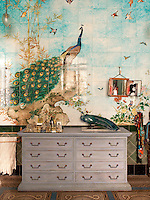 The master en suite hides a real treasure in the from of hand-painted tiles by French ceramicist and director of the famous porcelain factory in Sevres, Theodore Deck. Signed and dated 1886 they depict scenes of nature and peacocks. A chest of drawers provides storage in the bathroom.