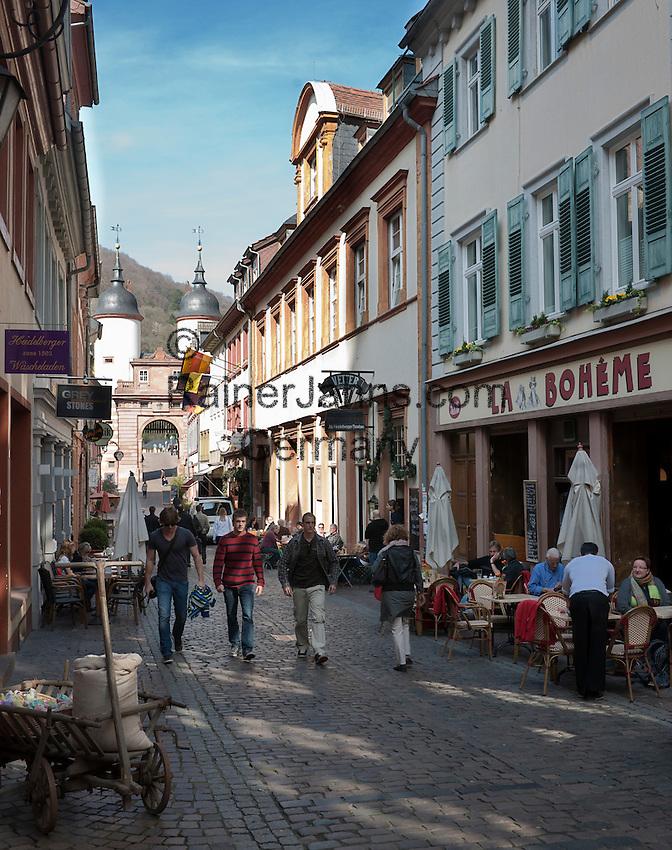 Germany, Baden-Wuerttemberg, Heidelberg: Cafes and restaurants at Steingasse lane, at background Old Bridge gate   Deutschland, Baden-Wuerttemberg, Heidelberg: Cafes und Restaurants in der Steingasse, am Ende das Brueckentor der Alten Bruecke