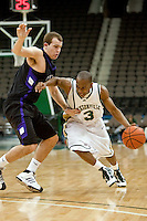 January 14, 2010:    Jacksonville guard Ben Smith (3) tries to drive around Lipscomb guard Jacob Arnett (5) duirng Atlantic Sun conference game action between the Jacksonville Dolphins and the Lipscomb Bisons at Veterans Memorial Arena in Jacksonville, Florida.  Jacksonville defeated Lipscomb 79-73.